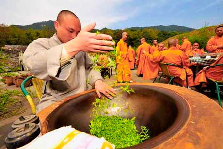 Buddhist Monks Hand shaping Zen tea